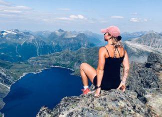 girl wearing fitbit on mountain