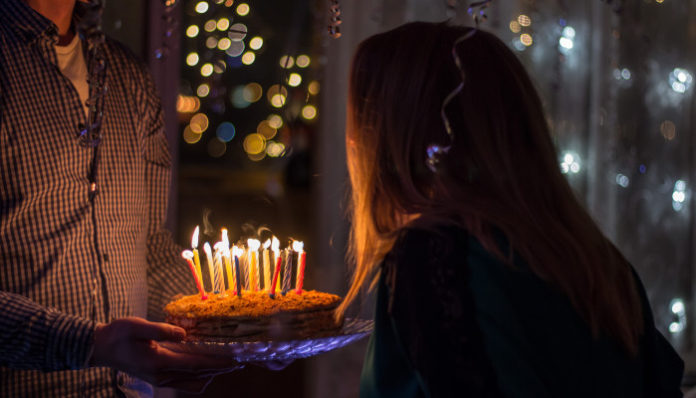 woman-blowing-candles-birthday